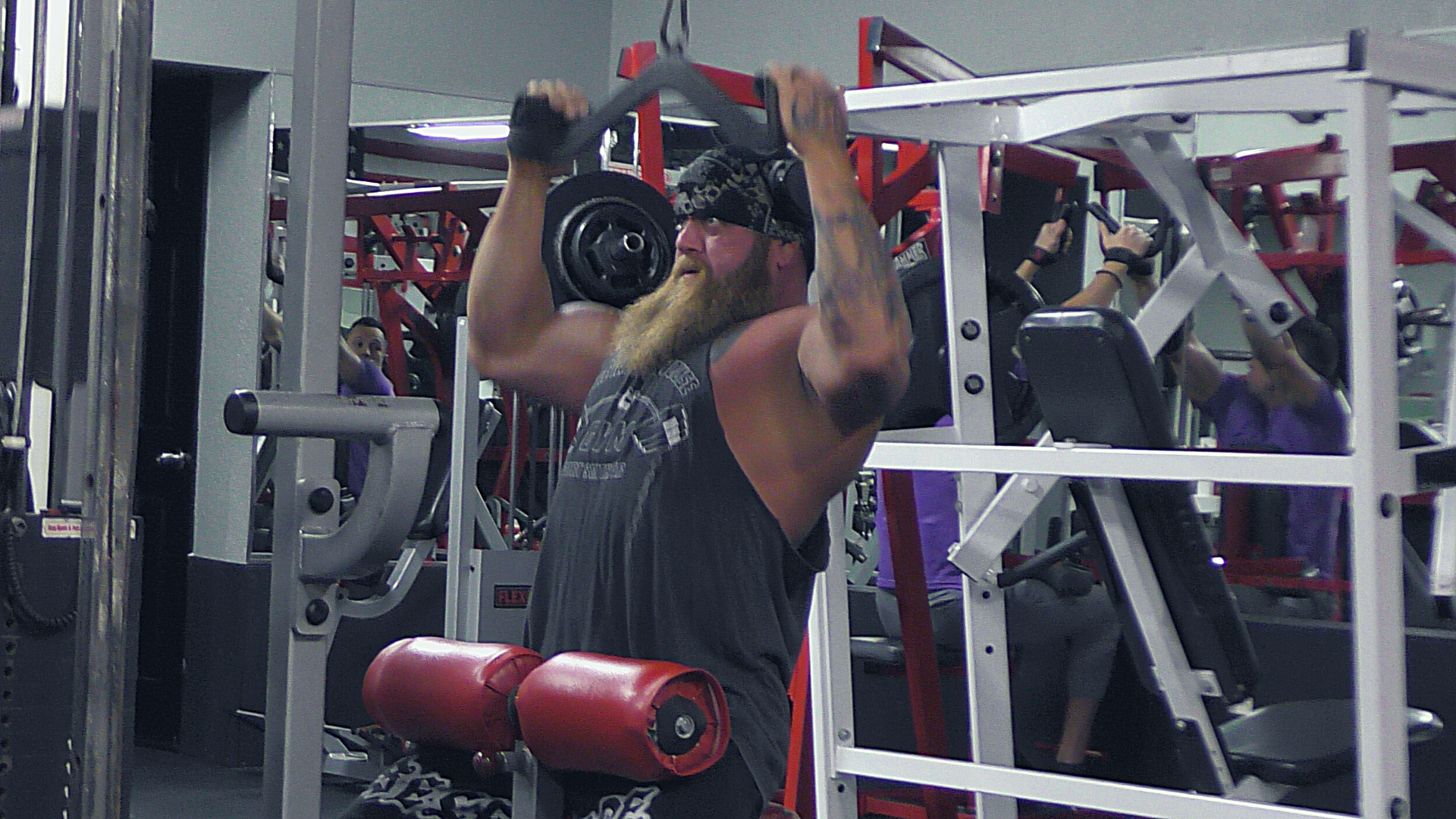 Man doing lat pulldowns in the gym